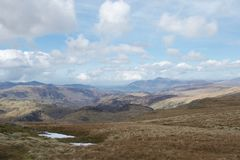 View from mountain in Lake District Cumbria, UK: lakes and mountains, blue sky and clouds stock images