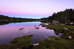 View of a mountain lake at dusk Royalty Free Stock Photography