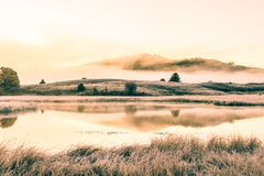 View of the mountain lake. Foggy morning royalty free stock photography