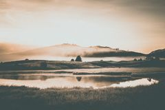 View of the mountain lake. Foggy morning royalty free stock photo