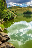View of a mountain lake in summer Stock Photos