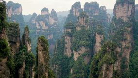 Mountain landscape of Zhangjiajie forest park with stone pillars rock formations. View mountain landscape with high stone pillars and rock formations in stock video