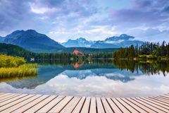 The view of mountain landscape with lake from wooden pier. Royalty Free Stock Photography