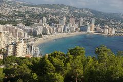 View from a mountain overgrown with pine trees on the coast of the Mediterranean city of Calp in Spain, the Costa Blanca region.  Stock Image