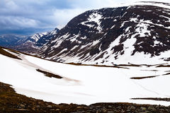 View from a mountain passage, tourists, snow Stock Photography
