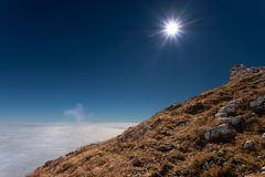 View from the mountain peak above the clouds Royalty Free Stock Images
