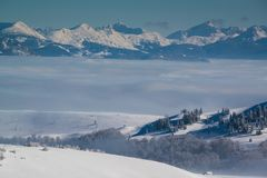 View of the mountain peaks above the clouds. In Montenegro Stock Photos