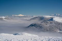 View of the mountain peaks above the clouds. In Montenegro Stock Photo