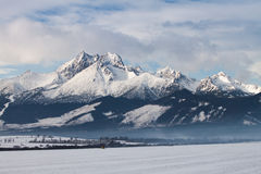 View of mountain peaks and snow in winter time, High Tatras Stock Images