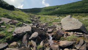 View of the mountain pond with a lot of roks stock footage