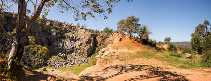 A view of a mountain quarry site from top of the rock in Greenmount National Park. Western Australia stock photo
