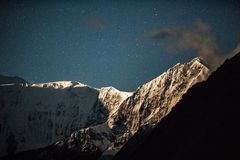 Night view on mountains Akkem Valley in Altai Mountains Natural Park, surroundings of Belukha Mountain. A view of the mountain range and Belukha mountain among royalty free stock photo