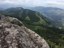 View of mountain range. Rocky top of a mountain. Green color Royalty Free Stock Photo