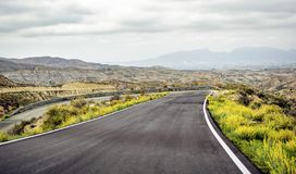 View of mountain road shrouded in fog royalty free stock image