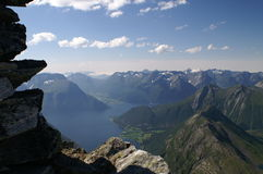 View from mountain Slogen, Norway. A view from the mountain Slogen, with many mountaintops and a fjord in the depth Royalty Free Stock Photo