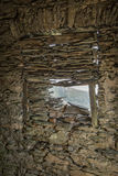 View of mountain through stone window frame in Corsica Stock Photography