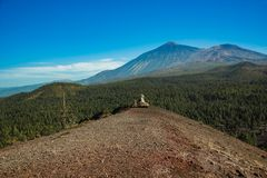 View of Mountain Teide from the top of Volcano Arenas Negras. Bright blue sky. Teide National Park, Tenerife, Canary Islands, royalty free stock photography