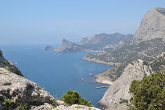 The view from the mountain to the sea. The village of Sudak in the Crimea royalty free stock photos