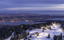 View from mountain top overlooking city lights Royalty Free Stock Photos