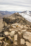 View from the mountain top to the snow-capped peaks Royalty Free Stock Photography