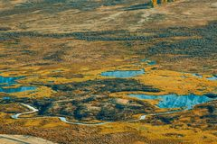 View of the mountain valley with rivers and lakes. Autumn season royalty free stock photography