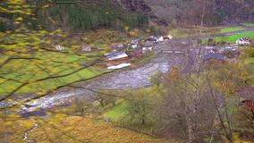 View of the mountain valley and village Flam. As seen from the scenic Flamsbana train line running between Flam and Myrdal as a part of Norway in a nutshell stock video footage