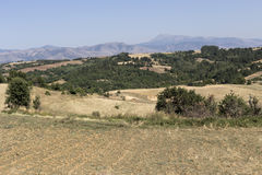 View of the mountain village. And arable land on a sunny day Macedonia, northwest Greece Royalty Free Stock Photos