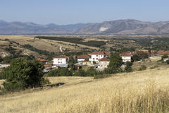View of the mountain village. And arable land on a sunny day Macedonia, northwest Greece Royalty Free Stock Photography