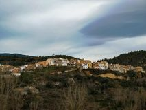 View of the mountain village of Fuente de la Reina. With gray sky outdoors unesco viewpoint building middle europe center history facade horizon mediterranean stock photo
