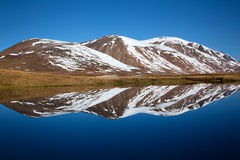 View of mountains. Reflecting on a lake Stock Photography