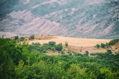 View of mountains Babadag in the clouds and a river Girdimanchay Lahij yolu from the side in Lahic village, Azerbaijan Royalty Free Stock Photos