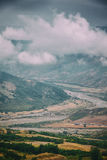 View of mountains Babadag in the clouds and a river Girdimanchay Lahij yolu from the side in Lahic village, Azerbaijan Stock Images