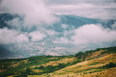 View of mountains Babadag in the clouds and a river Girdimanchay Lahij yolu from the side in Lahic village, Azerbaijan Stock Photography