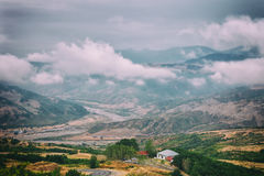 View of mountains Babadag in the clouds and a river Girdimanchay Lahij yolu from the side in Lahic village, Azerbaijan Royalty Free Stock Photo