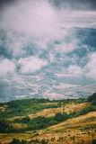 View of mountains Babadag in the clouds and a river Girdimanchay Lahij yolu from the side in Lahic village, Azerbaijan Royalty Free Stock Image
