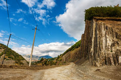 View of mountains Babadag and a muddy road along the river Girdimanchay Lahij yolu from the side in Lahic village, Azerbaijan Stock Images
