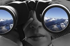 View of the mountains through a binoculars royalty free stock photo