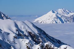 View on mountains and blue sky above clouds Royalty Free Stock Photo