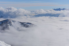 View on mountains and blue sky above clouds Royalty Free Stock Image