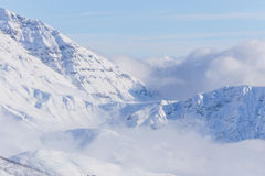View on mountains and blue sky above clouds Stock Photo
