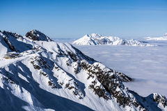 View on mountains and blue sky above clouds Stock Image