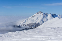 View on mountains and blue sky above clouds Royalty Free Stock Photography