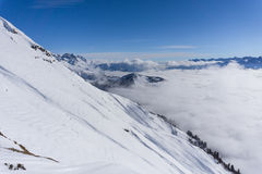 View on mountains and blue sky above clouds Royalty Free Stock Images