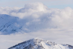 View on mountains and blue sky above clouds Stock Images