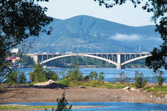 View of the mountains and the bridge. Across the Yenisey River in Krasnoyarsk, Russia Stock Photography