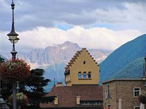 View of the mountains with a buliding in Bolzano, Italy.  stock photography