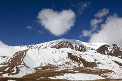 View of mountains with clouds. View of mountains with cloud like a heart in shape Royalty Free Stock Photos