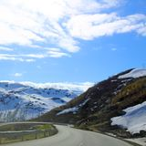 Curvy road in Norway. View on mountains and curvy road in spring Norway stock images