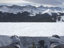 View of the mountains in the distance over a snowboard Royalty Free Stock Photo