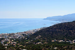 View from the mountains down to bay of Malia, Crete Greece Stock Photo